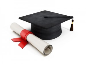 Mortar board and diploma isolated on white.