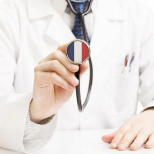 Doctor holding stethoscope with flag series - France